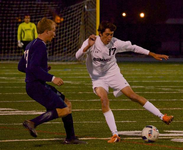 Senior defender Alan Castillo dribbles the ball around a Rifle player during the Senior Night game on Oct. 20. The Tigers won, 7-1, with all goals coming from seniors.
