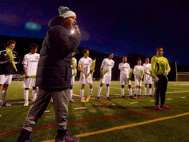 Summit soccer head coach Tommy Gogolen presents his senior players to the home crowd during senior night on Oct. 20. The Tigers beat Rifle, 7-1, with all goals coming from seniors.
