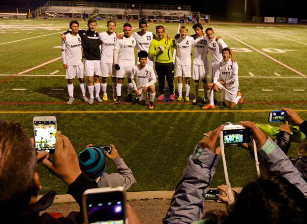 Parents and friends take photos of the 11 seniors on the Summit varsity soccer team during the Senior Night game on oct. 20. The Tigers defeated Rifle, 7-1, with all goals coming from seniors.