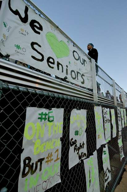 Handmade banners and signs hang on the fence at Tigers Stadium before the Senior Night home game for Summit boy's soccer. The Tigers beat Rifle, 7-1, with all goals coming from seniors.