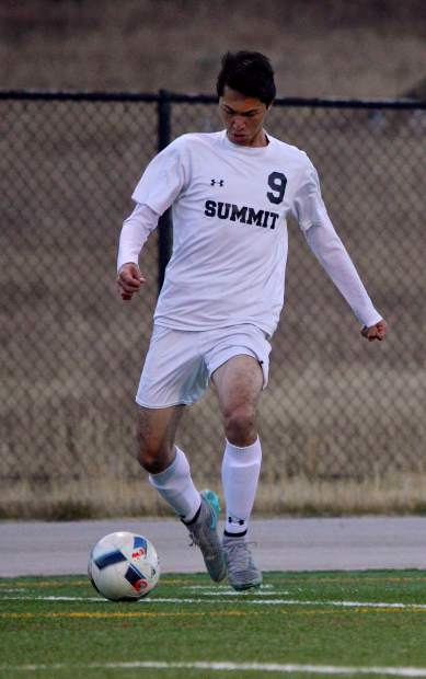 Summit senior midfielder Alfonso Zuno handles the ball in the first half of the Senior Night game against Rifle on Oct. 20. The Tigers won, 7-1, with all goals coming from seniors.