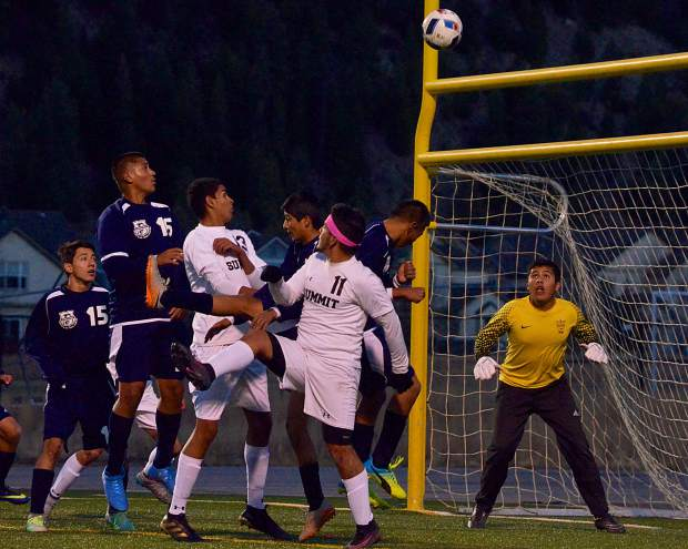 The Rifle goalkeeper eyes the ball as Summit defenders crash the net on a corner kick during the first half of the Senior Night game on Oct. 20. The Tigers won, 7-1, with all goals coming from seniors.