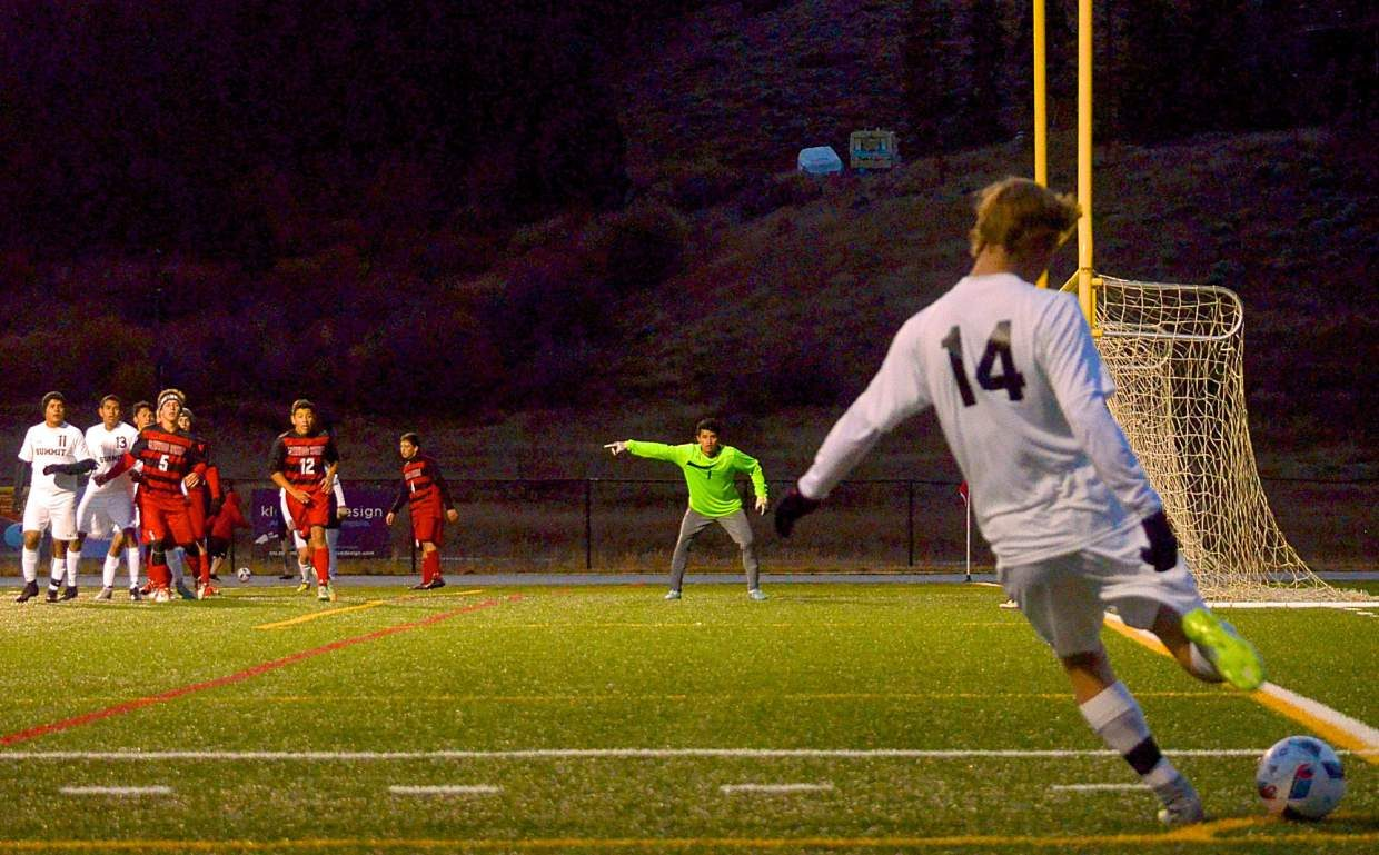 Summit's Jackson Stone takes a corner kick into traffic on the Glenwood Springs net during the first half of a home soccer game on Oct. 11. The Tigers won, 2-0.