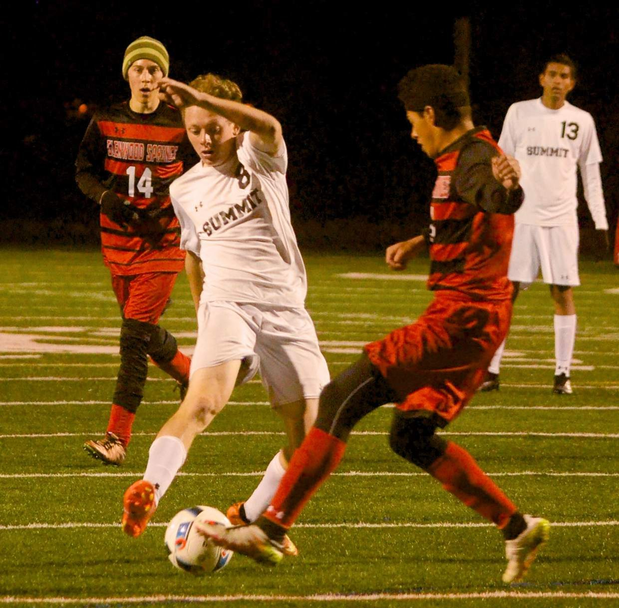 Summit junior midfielder Conor Craig winds through Glenwood Springs defenders during the second half of a home varsity soccer game on Oct. 11. The Tigers won, 2-0.