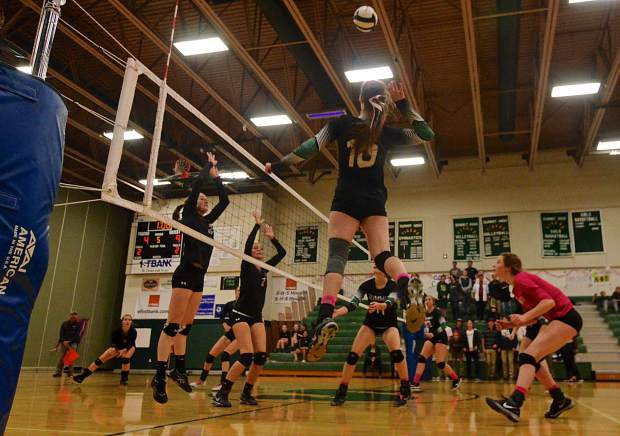 Summit senior hitter Sam Buer (No. 10) goes for a kill against Steamboat Springs during the fifth set of a home volleyball game on Oct. 20. The Tigers lost in five after coming back to tie things in the fourth set.