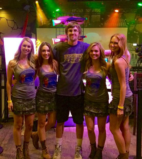 Summit County's Danny Arbuckle with the Buck Girls at the 2015 Big Buck World Championship in Chicago. Arbuckle makes his third trip to the championship on Nov. 5 for a chance at the $20,000 grand prize.