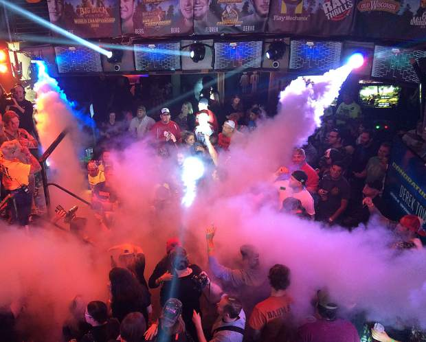 Smoke and lasers at the main arcade arena during the 2015 Big Buck World Championships at the Hard Rock Hotel in Chicago. On Nov. 5, Summit County local Danny Arbuckle travels to the 2016 championship for a shot at the $20,000 grand prize after qualifying as one of the top arcade players in Colorado.