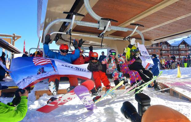 A group of Colorado locals breaks through the first-chair banner to welcome opening day at Breckenridge Ski Resort on Nov. 19. More than 3,000 skiers and snowboarders came to Breck for top-to-bottom skiing on two runs: Crescendo and lower Springmeier.