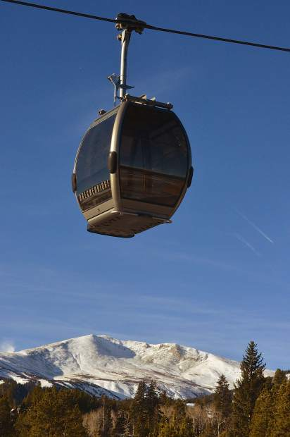 A gondola cabin at Breckenridge floats over the summit of Peak 10 shortly before the first chair of the 2016-17 ski season on Nov. 19. More than 3,000 skiers and snowboarders came to Breck for top-to-bottom skiing on two runs: Crescendo and lower Springmeier.