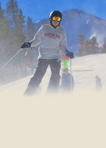 A skier nearly disappears in a puff of snow when the wind kicked up on lower Springmeier during opening day at Breckenridge Ski Resort on Nov. 19. More than 3,000 skiers and snowboarders came to Breck for top-to-bottom skiing on two runs: Crescendo and lower Springmeier.