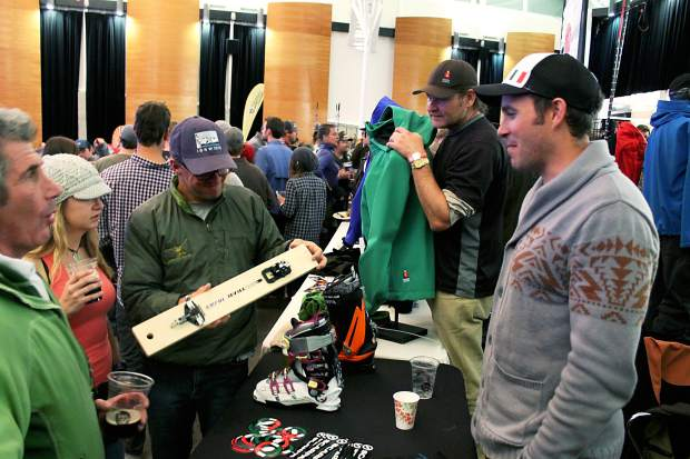Attendees of the seventh-annual CAIC Benefit Bash in 2014 learn about Scarpa products. The Bash returns to the Riverwalk Center in Breckenridge this year on Dec. 3.