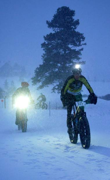 Topeak-Ergon pro Dave Wiens (front) pedals through snow ahead of Summit County's Taylor Shelden during the Ullr Bike at Gold Run Nordic Center in January 2015. Fat-bike racing and Shelden return to Breckenridge with the Fat Bike Open in Breckenridge on Dec. 3.