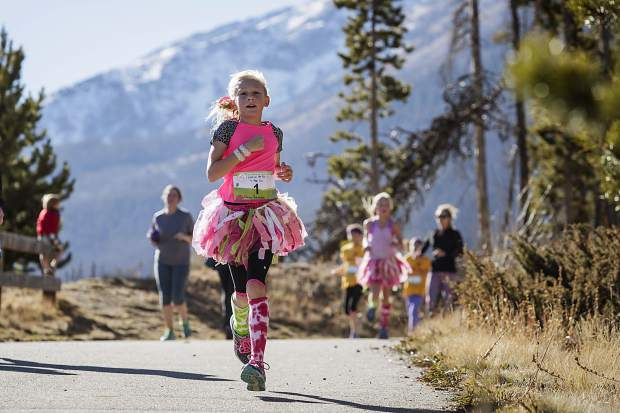 A costumed runner barrels down the rec path during the second annual Girls on the Run 5K in Frisco on Nov. 12. The event drew more than 600 young runners from across the Rocky Mountain region.