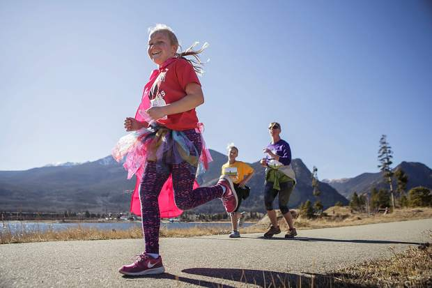 A young runner in full pink regalia zooms past Lake Dillon during the Girls on the Run 5K in Frisco on Nov. 12.
