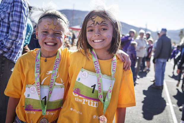 Two young runners are all smiles after finishing the Girls on the Run 5K in Frisco on Nov. 12.