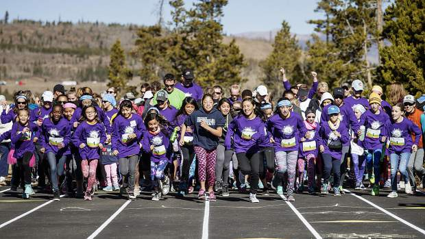 Young runners leave the start line during the second annual Girls on the Run 5K in Frisco on Nov. 12. The event drew more than 600 elementary school runners and their families from across the Rocky Mountain region.