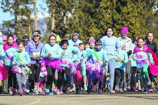 Runners at the first-annual Girls on the Run 5K in Frisco take off from the start line in 2015. The event returns for a second year to a course around Lake Dillon on Nov. 12.