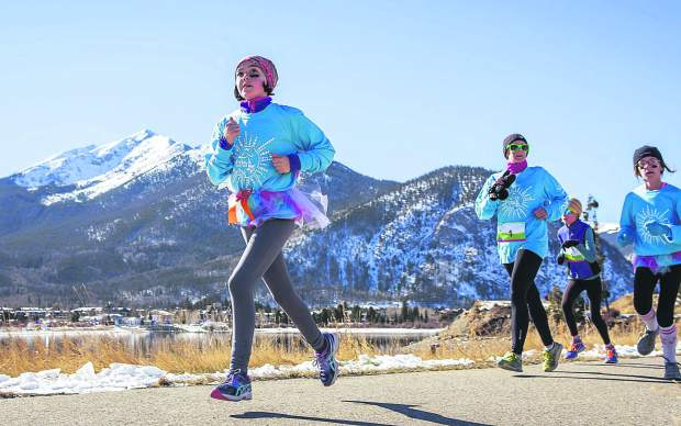 A group of girls runs past Lake Dillon with Peak One in the background during the first-annual Girls on the Run 5K in Frisco in 2015. The event returns on Nov. 12 and is expected to bring 600-plus runners from across the Central Rocky Mountains.