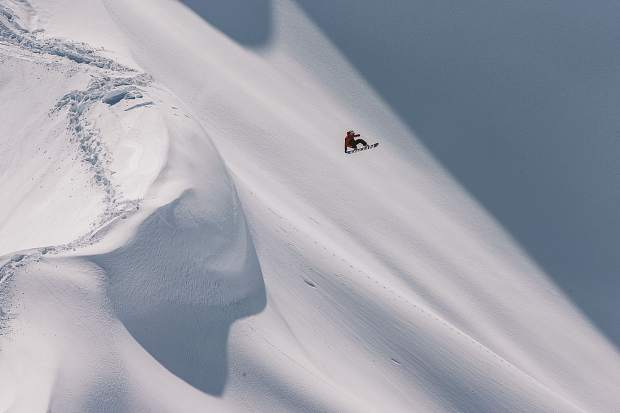 Pro Victor de Le Rue performs in the Jackson Hole backcountry while filming for
