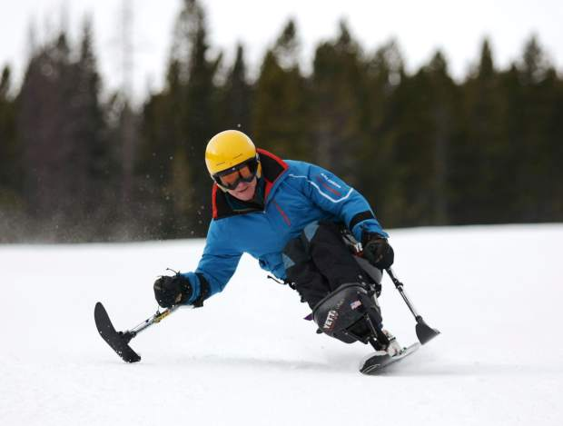 Monoskier Bob Meserve, the former board president for Disabled Sports USA, lays down carves during The Hartford Ski Spectacular in 2015. The annual event for adaptive skiers and snowboarders returns for its 29th season to Breckenridge from Nov. 28 to Dec. 4.