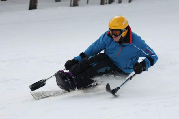 Bob Meserve of Disabled Sports USA on the snow in a monoski during The Hartford Ski Spectacular in 2015. Meserve, a former U.S. Paralympic ski team member, joins more than 800 adaptive skiers and snowboarders at the Ski Spectacular in Breckenridge from Nov. 28 to Dec. 4.