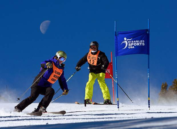 A blind skier maneuvers through a slalom course with an assistant during The Hartford Ski Spectacular at Breckenridge in 2015. The annual event for adaptive skiers and snowboarders returns for its 29th season to Breckenridge from Nov. 28 to Dec. 4.