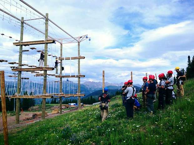 Employees at Adventure Ridge on Vail Mountain receive training on the ropes challenge course. Breckenridge's proposed expansion will include similar activities which officials say are designed to expose guests to the outdoors.