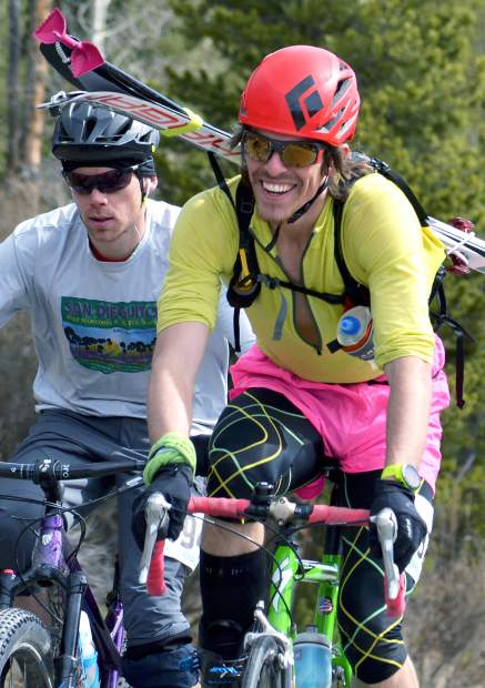 Competitors at the 2016 Imperial Challenge ride up Barton Road in full regalia during the first leg of the annual race. For decades, the race has combined three sports — biking, uphill travel and downhill skiing — long before the rise of cross-recreating.