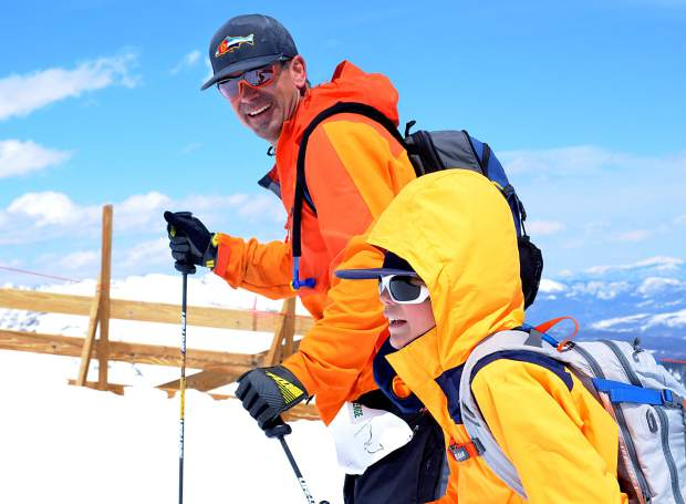 A father-son team smile during a break on Imperial Ridge at the 2016 Imperial Challenge in Breckenridge on April 22. The newest generation of outdoor junkies in Colorado is increasingly drawn to multiple sports, not just one, according to the state's new Outdoor Recreation Industry Office.