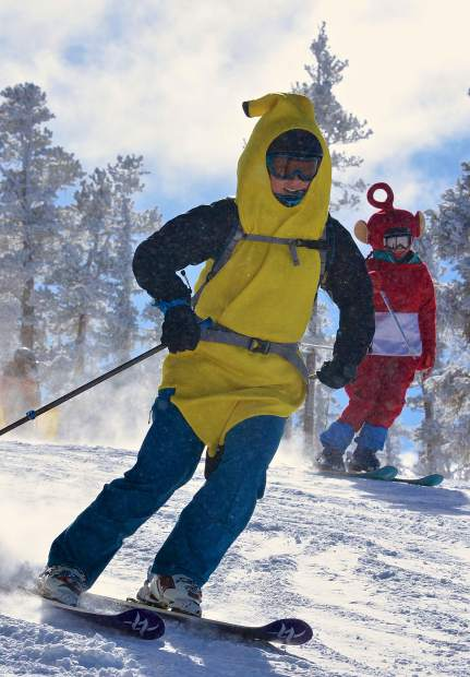 A banana and Teletubby ski down the middle pitch of Spring Dipper on opening day at Keystone Resort Nov. 18.
