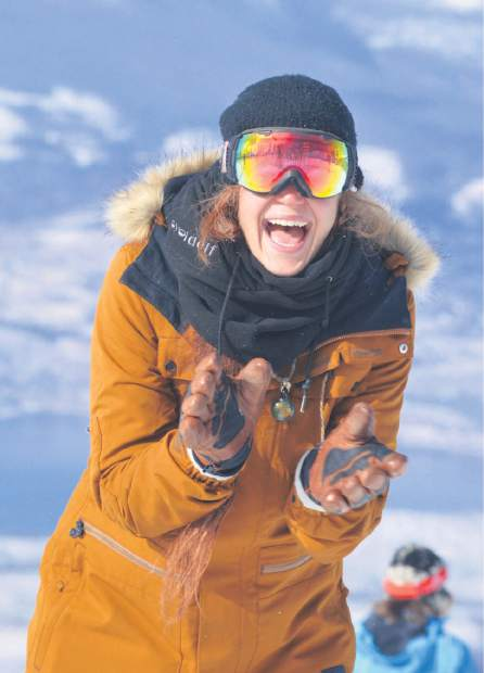One look says it all: A snowboarder laughs near the top of Dercum Mountain at Keystone Resort on opening day Nov. 18. Hundreds of skiers and snowboarders came out for the first opening day of the season with fresh, natural snow.