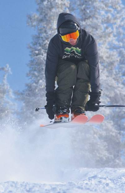 A skier tucks off a bump after 5 inches of fresh snow fell at Keystone Resort before opening day on Nov. 18.
