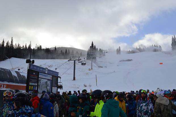 The lines weren't too long at first, but skiers and boarders turned out in forcefor Copper's top to bottom skiing. Snow was still blowing on the runs as people went down them.