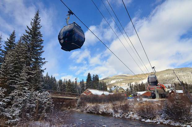 The River Run Gondola starts spinning for opening day at Keystone Resort on Nov. 18. More than 200 skiers and snowboarders packed into the line at the gondola for first cabin after a storm brought 5 inches the night before.