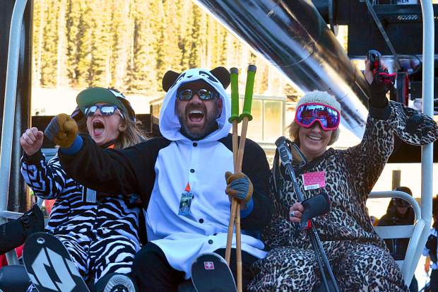 The pajama squad (left to right) Olivia Hall, Michael Kin and Abby Meyers on the second chair of the 2016-17 ski season at Loveland Ski Area on Nov. 10. The three camped out overnight to get in line after the ski area confirmed it would open about three weeks later than expected.