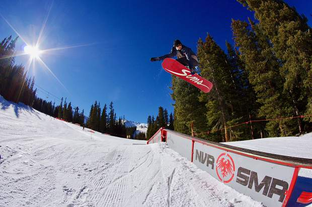 A snowboarder sends a method over the gap to the down bar at Loveland Ski Area on opening day Nov. 10. The ski area opened with five terrain park features and three runs.