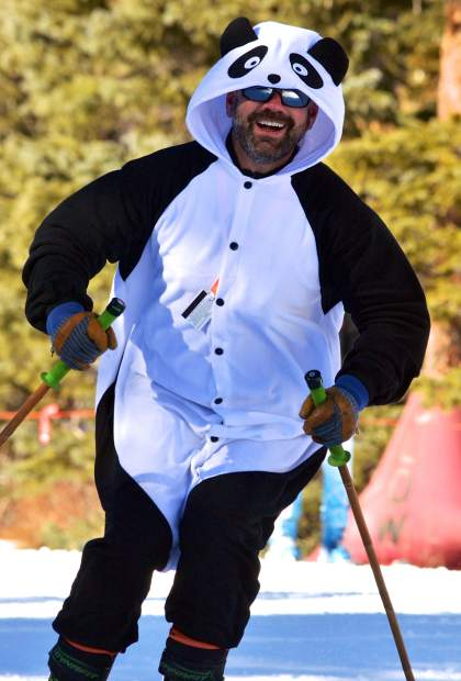 Michael Kin of Evergreen in his finest panda tuxedo for opening day at Loveland Ski Area on Nov. 10. Roughly 1,500 skiers and snowboarders from across the state joined dozens of local and national youth ski clubs for the first tracks of the 2016-17 season.