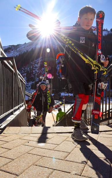 Ski club athletes at the base area of Loveland Ski Area on opening day Nov. 10. Clubs from across the nation come to Loveland, Arapahoe Basin and Copper Mountain for early-season training, despite the fact this October was warmer than average and came with little snowfall.