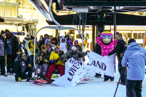 The first chair of the 2016-17 ski season leaves the base of Loveland Ski Area with longtime Summit County locals (left to right) Zach Griffin, Tom