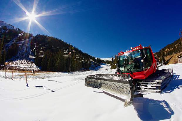 A snowcat puts the final touches on snow at the base area of Loveland Ski Area in early November. The resort opens for the 2016-17 ski season today, with riding on Mambo, Catwalk and Home Run from 9 a.m. to 4 p.m.