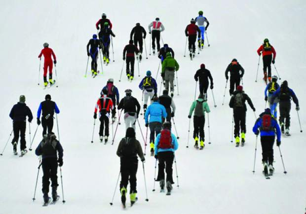 Skiers take off from the base of Arapahoe Basin for the ski area's annual uphill race series, the Rise and Shine Rando series. The series debuts Nov. 29 with an uphill-downhill criterium at 7 a.m.