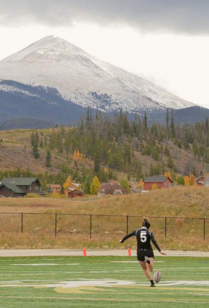 Summit senior Natalie Gray kicks from the midfield with a snowy Bald Mountain in the background during a home sevens rugby tournament on Sept. 24. Gray and the two Summit sevens teams travel to Infinity Park in Denver on Nov. 12 to defend their titles in the state high school girl's rugby championships.