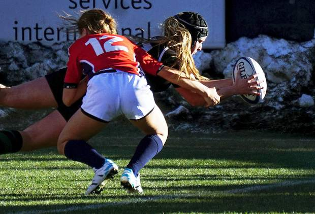 A Summit player scores a try during the team's 64-7 win over Chaparral to claim the Colorado state rugby title at Infinity Park in Denver in 2015. The two Summit sevens teams travel back to Infinity Park on Nov. 12 to defend their titles in the state high school girl's rugby championships.