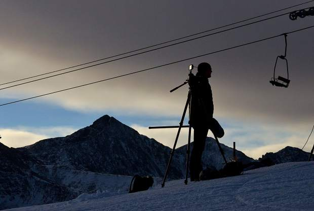 A coach waits for athlete footage at the top of the U.S. Ski Team Speed Center at Copper Mountain in November.
