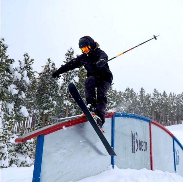 Team Breck's Noah Begley hangs five (or whatever skiers call it) on a rainbow rail at Breckenridge.