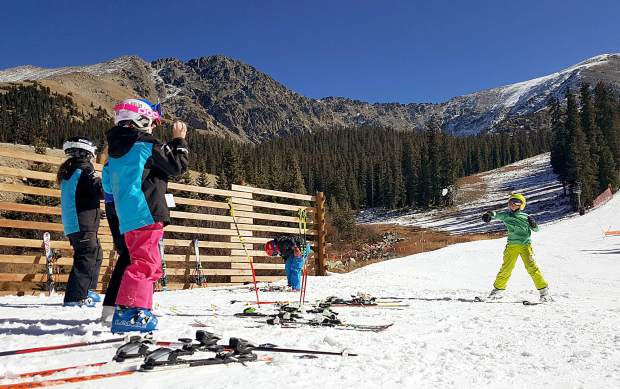 U-12 athletes with the Steamboat Springs Winter Sports club relax at the base of High Noon at Arapahoe Basin on Nov. 3. The ski club brought more than 20 skiers and snowboarders to A-Basin after missing a weekend of training at Loveland, which is closed due to low snow in October.