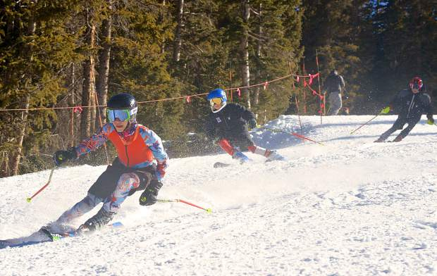 A trio of ski club athletes carve turns down the lower face of Mambo during opening day at Loveland Ski Area on Nov. 10. The ski club racers joined roughly 1,500 other skiers and snowboarders for tracks on three runs: Catwalk, Mambo and Home Run.