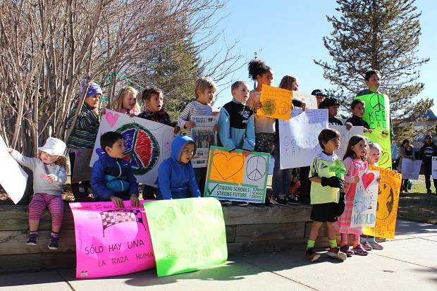 Demonstrators gathered all of the kids together in a group at Frisco Town Hall as part of their peaceful rally against bullying and discrimination in schools.
