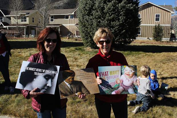 Deborah McLaughlin (left) and Nancy Hassinger (right) joined in the peaceful rally against discrimination in schools. Hassinger said that at age 75 she has become a professional protester after joining in on the anti-Trump protests in Denver.