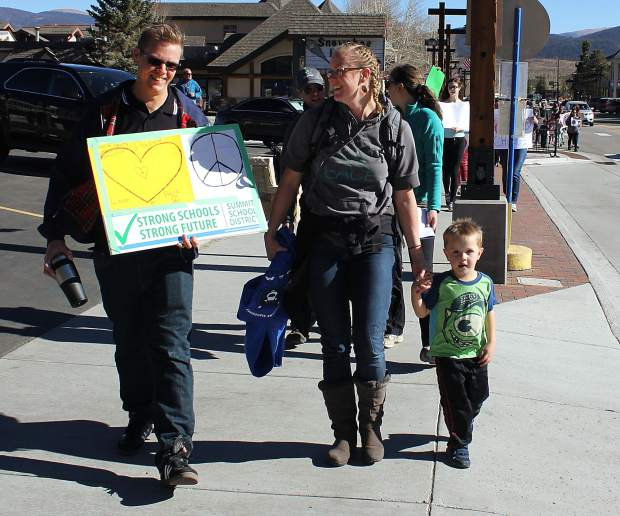 Dillon Mayor, Kevin Burns (left) joined Karin Mitchell at the peace rally organized by Summit County Moms.